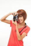 Asian woman and camera Stock Images