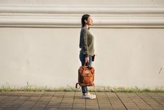 Free Asian Woman Carrying A Bag Stock Image - 101671681