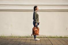 Asian woman carrying a bag stock image