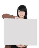 Asian woman carrying a blank paper. Isolated on white background Royalty Free Stock Photos