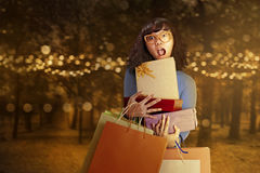 Asian woman carrying many lot of gifts Royalty Free Stock Image