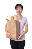 Asian Woman carrying shopping bag with groceries Royalty Free Stock Photo
