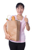 Asian Woman carrying shopping bag with groceries Stock Photography