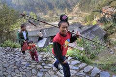 Asian woman carrying a yoke Stock Photography