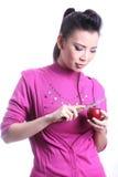Asian woman casing apple Stock Photos