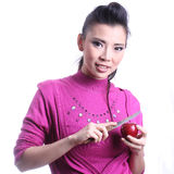 Asian woman casing apple Royalty Free Stock Image