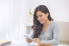 asian woman in casual using mobile phone Stock Image