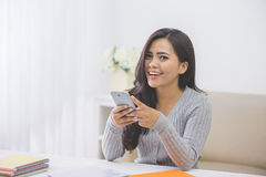Asian woman in casual using mobile phone Royalty Free Stock Photos