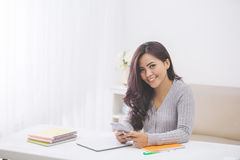 Asian woman in casual using mobile phone Royalty Free Stock Images