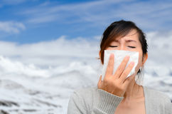 Asian woman catch a cold with snow Stock Image