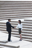 Asian Woman Caucasian Businessman Handshake City Steps Royalty Free Stock Image