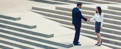 Asian Woman Caucasian Businessman Handshake City Steps royalty free stock photos