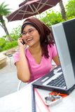 Asian woman on cell phone outdoor Stock Image