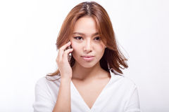 Asian woman on cellphone stock images