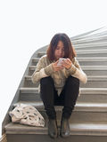 Asian woman with cellphone Royalty Free Stock Photos