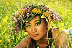 Asian woman with chaplet. Asian woman in nature with chaplet on head Royalty Free Stock Image