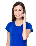Asian woman chat on cellphone Stock Photography