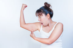 Asian woman checking her upper arm Stock Images