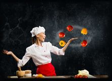 Asian woman chef juggling with vegetables Stock Images