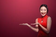 Asian woman in cheongsam dress Stock Photography