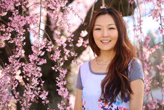 Asian Woman with Cherry Blossom or Sakura. Smiling Happy Girl stock photo