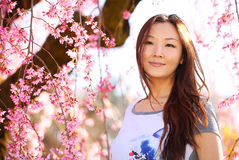 Asian Woman with Cherry Blossom or Sakura. Smiling Happy Girl Royalty Free Stock Image