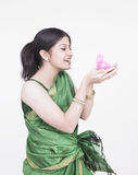 Asian woman with a chick Royalty Free Stock Photos