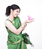 Asian woman with a chick. Young asian woman of indian origin with a pink coloured chick Royalty Free Stock Photo