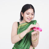 Asian woman with a chick Royalty Free Stock Images