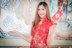 Asian woman in chinese dress holding couplet 'Happy' (Chinese w Stock Images