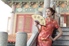 The Asian woman in chinese dress holding couplet 'success' (Chin Royalty Free Stock Image