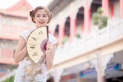 The Asian woman in chinese dress holding couplet 'success' (Chin Stock Images