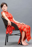Asian woman in chinese red. Royalty Free Stock Photos