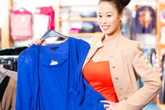 Asian Woman choosing clothes in fashion shop Royalty Free Stock Photo