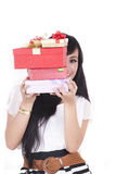 Asian Woman with Christmas Gift. Asian woman hides while holding a stack of christmas gift Royalty Free Stock Photos