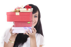 Asian Woman with Christmast present. Close up of asian woman hides behind a stack of christmas gift Royalty Free Stock Image