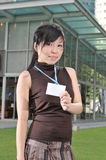 Asian Woman In The City showing her pass stock photo