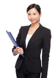Asian woman with clipboard Stock Photo