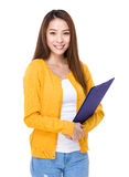 Asian woman with clipboard Stock Images