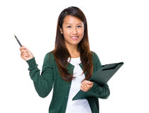 Asian woman with clipboard and pen up Stock Photos