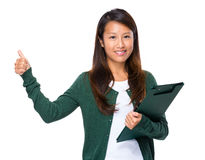 Asian woman with clipboard and thumb up Royalty Free Stock Image