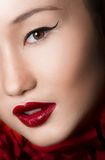 Asian Woman Close up With glamour make up and red. Lips. Studio fashion shot Royalty Free Stock Photography