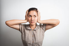 Asian woman with closed ears Stock Photography
