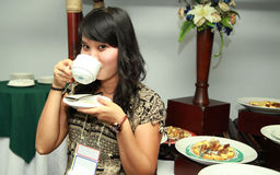Asian woman at coffee break Stock Photography