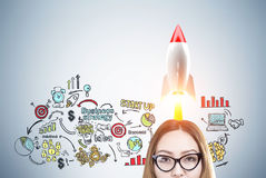 Asian woman and colorful rocket start up Stock Photography