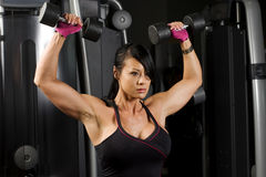 Asian Woman Concentrating While Working Out Stock Photo