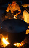 Asian woman cook, firewood stove Stock Images