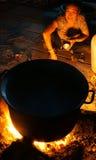 Asian woman cook, firewood stove Stock Image