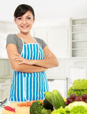 Asian woman cooking. In the kicthen Stock Photography