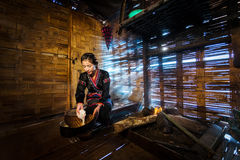 Asian woman cooking at house in rural Laos. stock photography